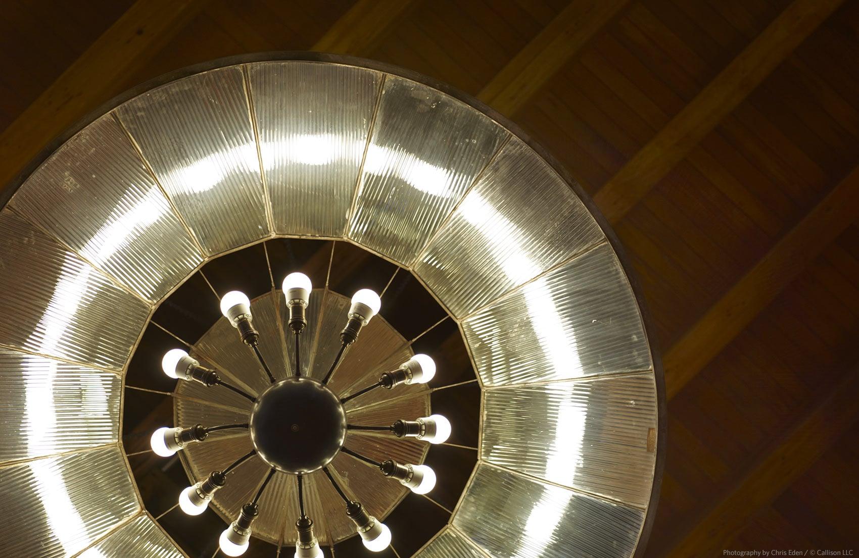 REI, Soho - NYC - Historical lighting fixture reuse